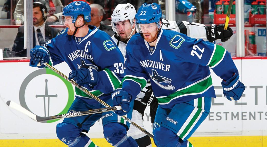 Henrik-Sedin-and-Daniel-Sedin-of-the-Vancouver-Canucks-pursue-the-puck