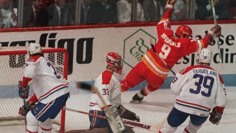 Calgary-Flames'-Lanny-McDonald-(right)-raises-arms-after-scoring-against-Canadiens-in-Stanley-Cup-final-in-Montreal,-May-25,-1989.-(Paul-Caiasson/CP)