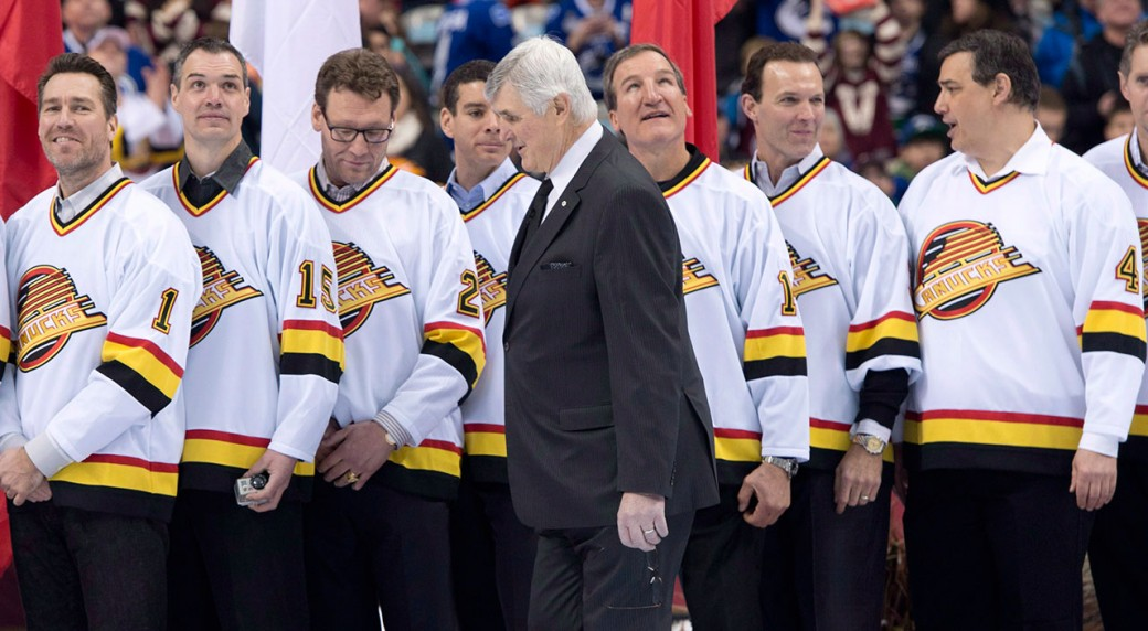 Pat Quinn walks past former members of the Vancouver Canucks prior to the  Heritage Classic hockey game at BC Place in Vancouver 3b545d062