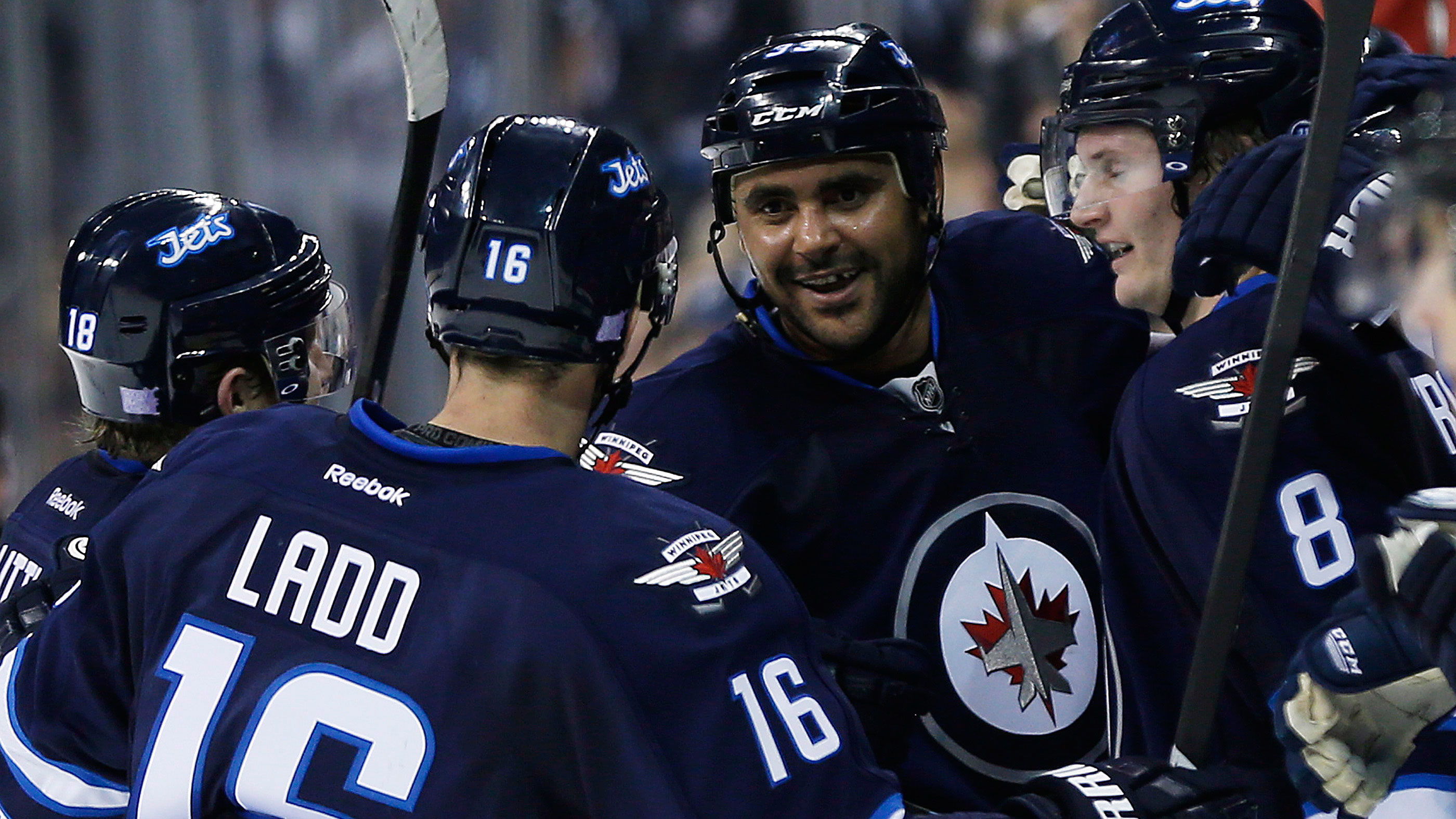 Winnipeg Jets' Andrew Ladd and Dustin Byfuglien celebrate a goal. (John Woods/CP)