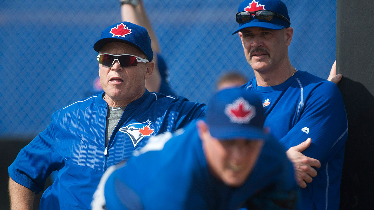 Toronto Blue Jays pitcher Aaron Sanchez, front, pitches in the bullpen as Blue Jays manager John Gibbons, left, and pitching coach Pete Walker, right, watch during baseball spring training in Dunedin, Fla., on February 24, 2015. (Nathan Denette/CP)