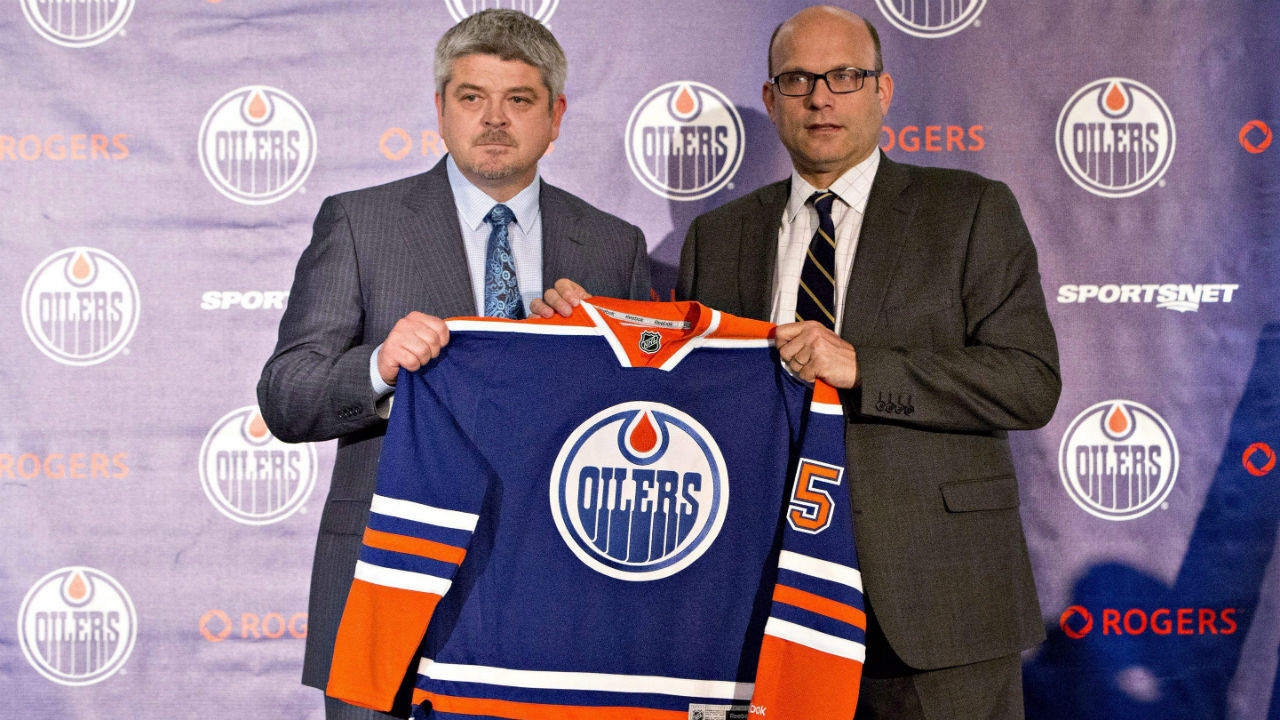 Todd McLellan, left, and Peter Chiarelli, President of Hockey Operations and General Manager of the Edmonton Oilers, hold up a jersey during a press conference after the Oilers announced McLellan as their new head coach in Edmonton, Alta., on Tuesday May 19, 2015. (Jason Franson/CP)