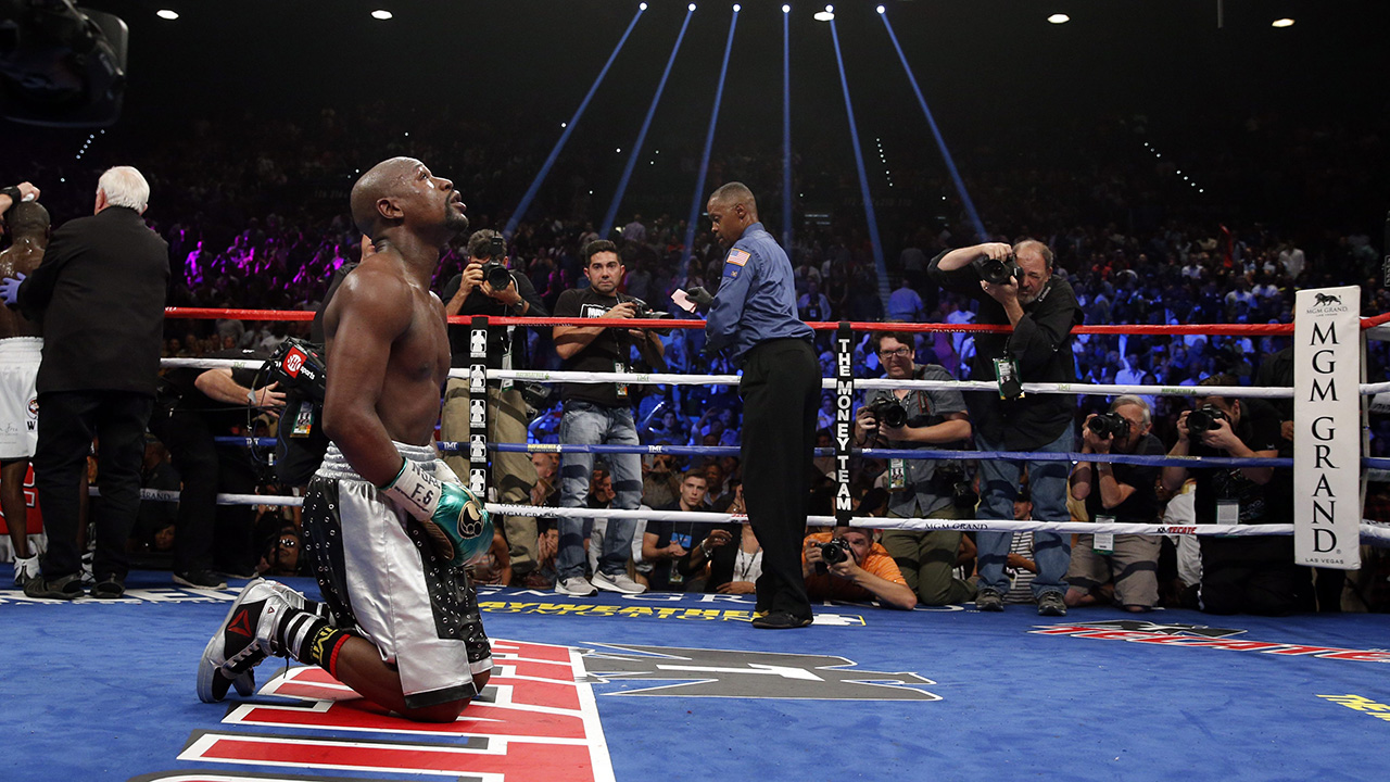 Floyd Mayweather Jr. kneels at the end of his welterweight title bout on Saturday in Las Vegas. (John Locher/AP)