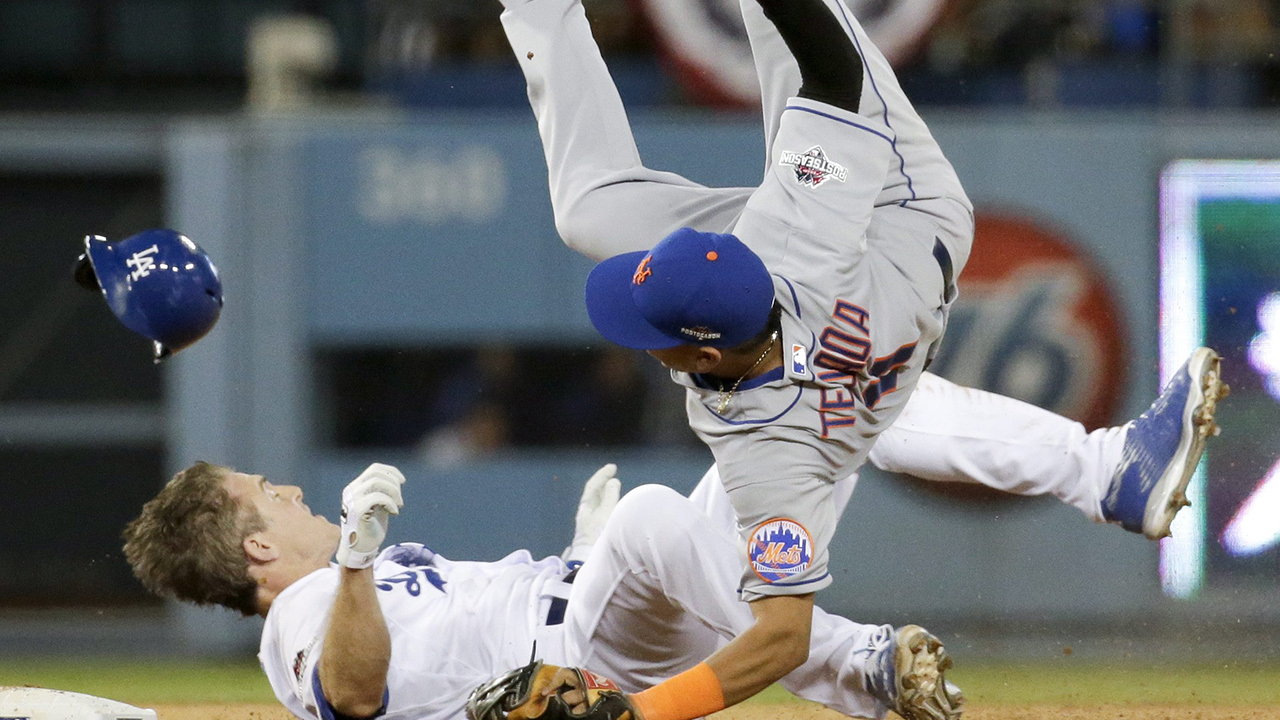 New York Mets shortstop Ruben Tejada, goes over the top of Los Angeles Dodgers' Chase Utley. (Gregory Bull/AP)