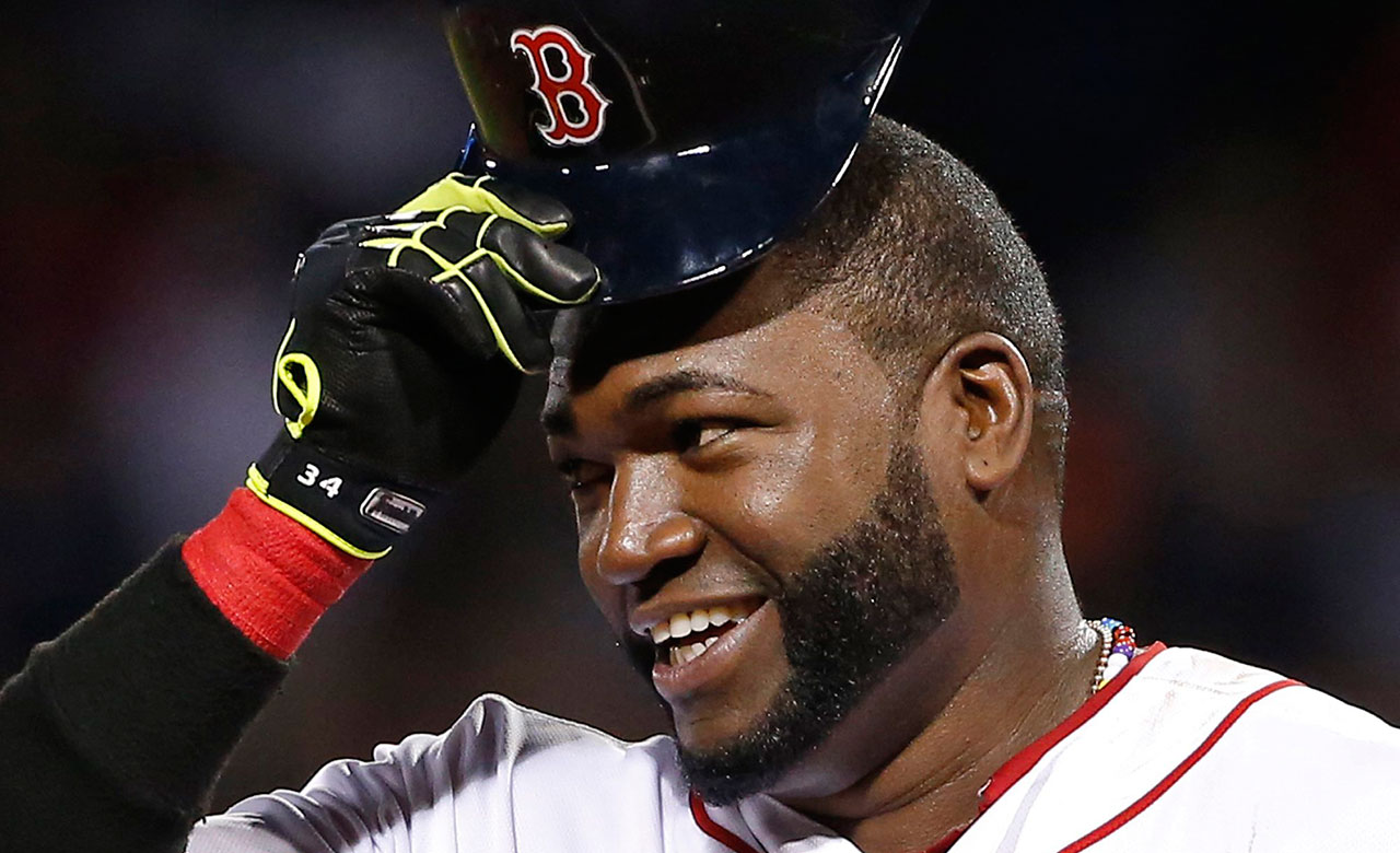 Boston Red Sox designated hitter David Ortiz tips his cap while standing on third base during a baseball game (Elise Amendola/AP)