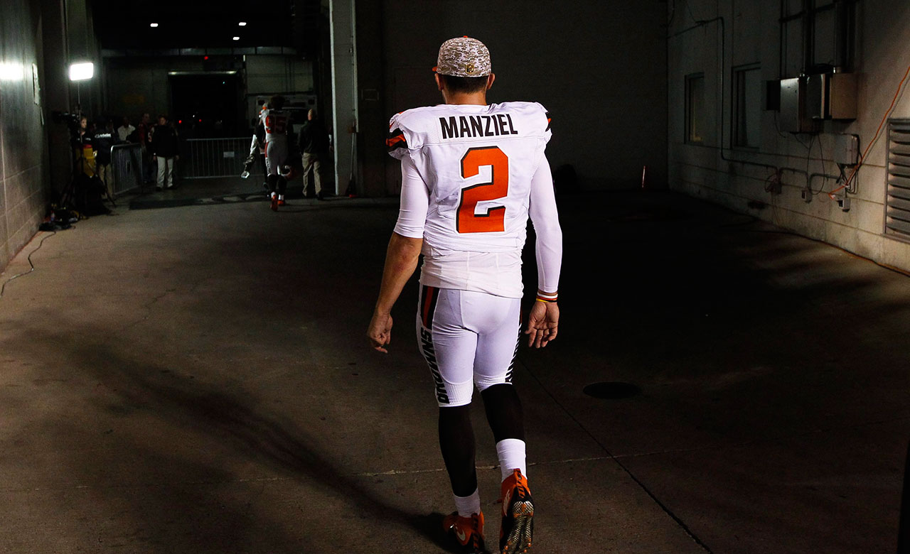 790a56c6ae2 Pettine benched Manziel for violating team's trust. Former Cleveland Browns  quarterback Johnny Manziel walks off the field ...