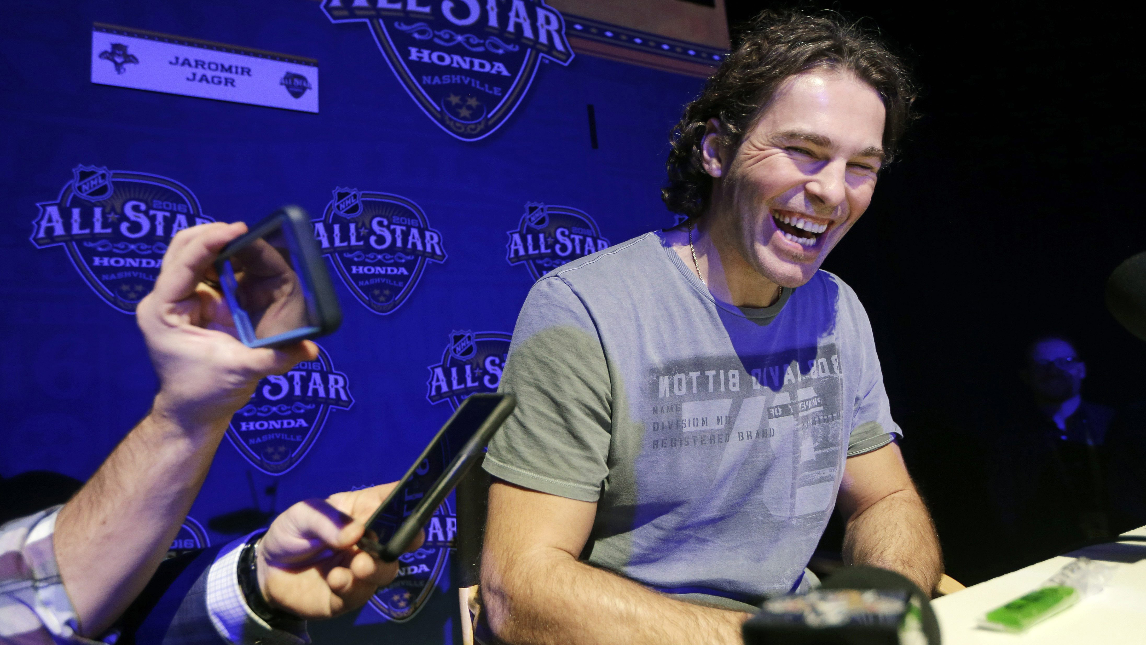 Jaromir Jagr laughs as he talks with reporters at the NHL hockey All-Star game media day. (Mark Humphrey/AP)