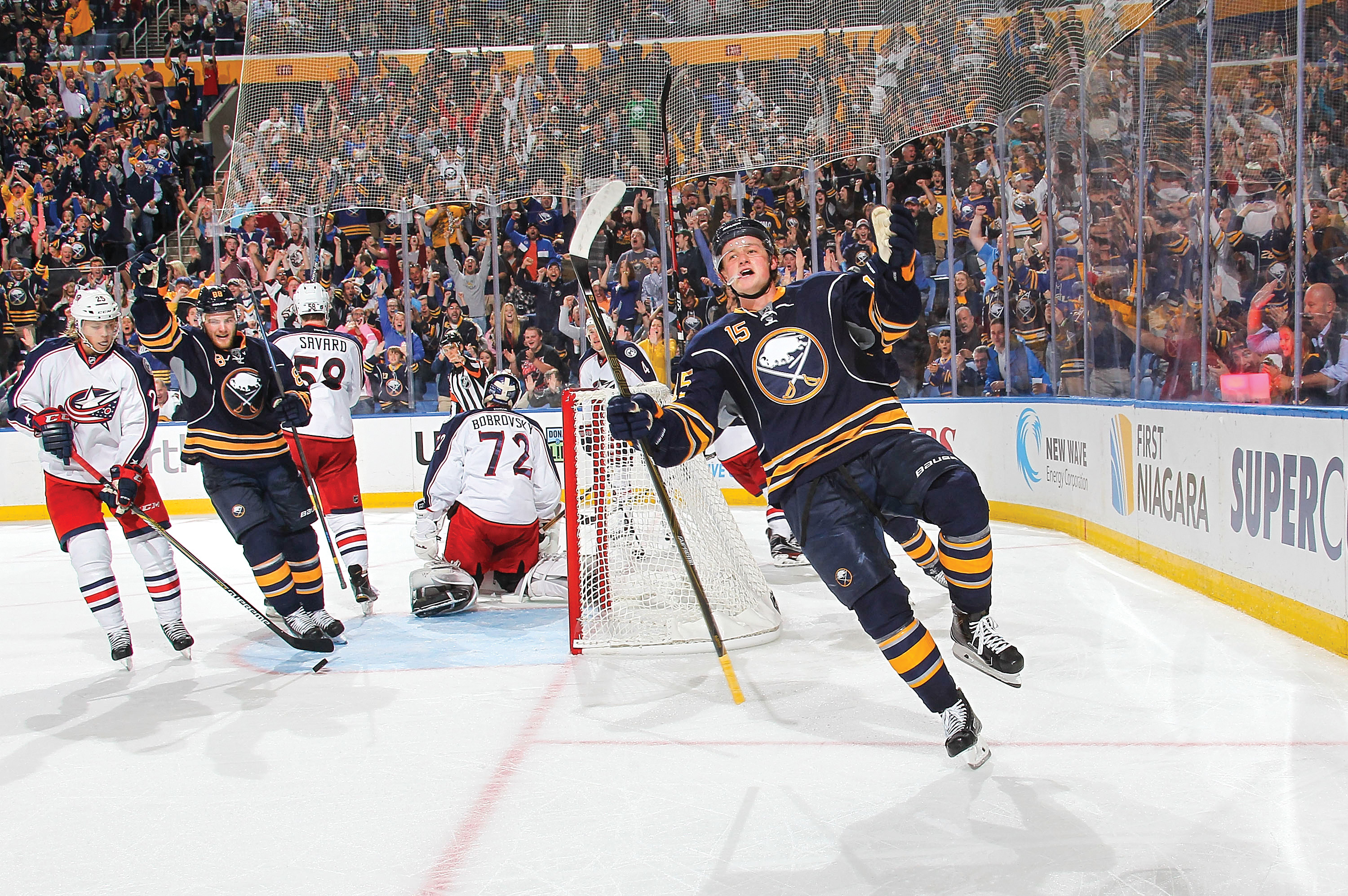 BUFFALO, NY - OCTOBER 12:  Jack Eichel #15 of the Buffalo Sabres celebrates his third period goal against Sergei Bobrovsky #72 of the Columbus Blue Jackets on October 12, 2015 at the First Niagara Center in Buffalo, New York. Buffalo won, 4-2.  (Photo by Bill Wippert/NHLI via Getty Images)