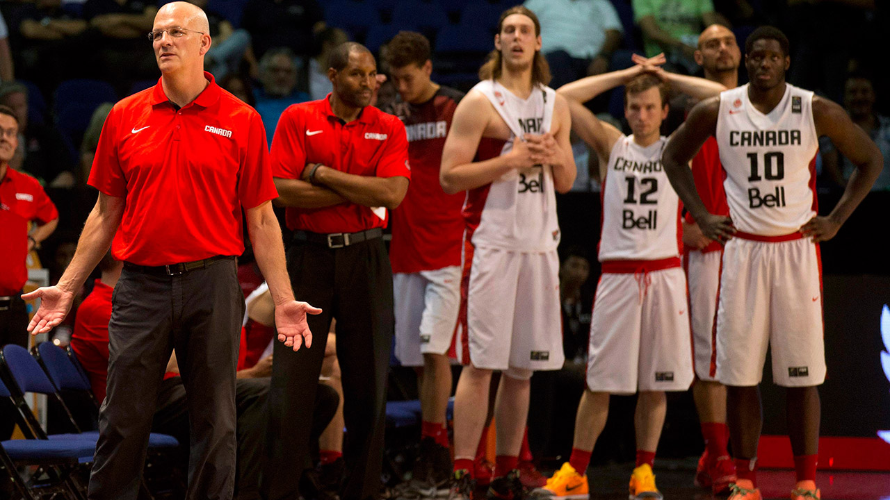 Jay Triano and the Canadian players react in the dying moments of Canada's loss to Venezuela. (Eduardo Verdugo/AP)