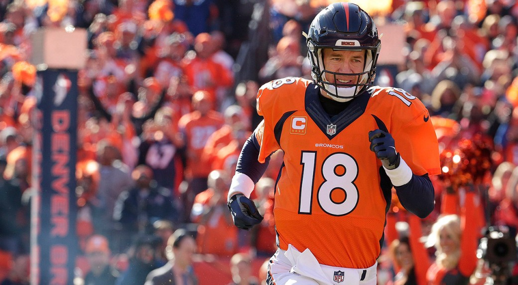 Denver Broncos quarterback Peyton Manning runs onto the field for the first  half of the AFC Championship game. (Charlie Riedel AP) baa7cd72e