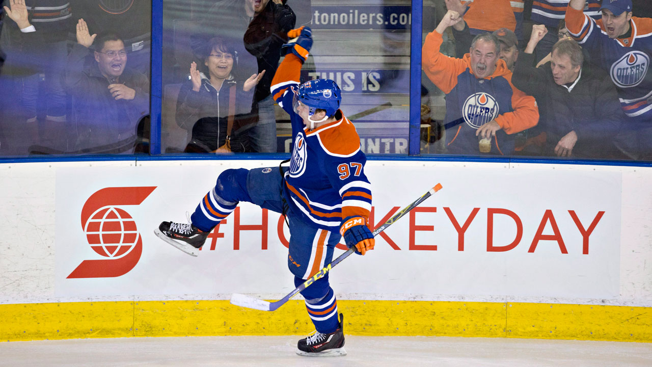 Connor McDavid celebrates a goal in his return from a broken collarbone. (Jason Franson/CP)