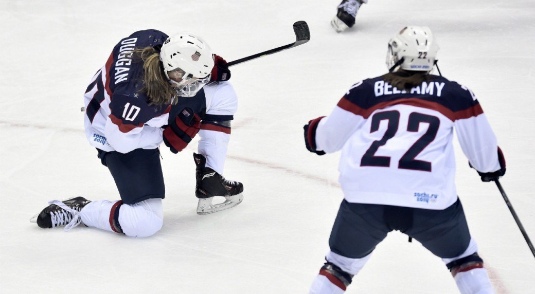 830bbf6d039 USA s Meghan Duggan celebrates her goal with teammate Kacey Bellamy during  second period women s hockey final action at the 2014 Sochi Winter Olympics  in ...