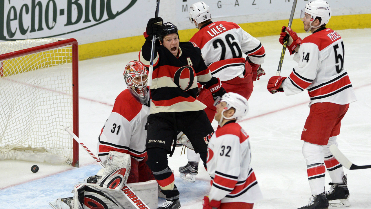 Ottawa Senators' Chris Neil celebrates the winning goal scored by Cody Ceci, not shown, against Carolina Hurricanes goalie Eddie Lack during third period NHL hockey action in Ottawa on Thursday, Feb. 18, 2016. THE CANADIAN PRESS/Sean Kilpatrick