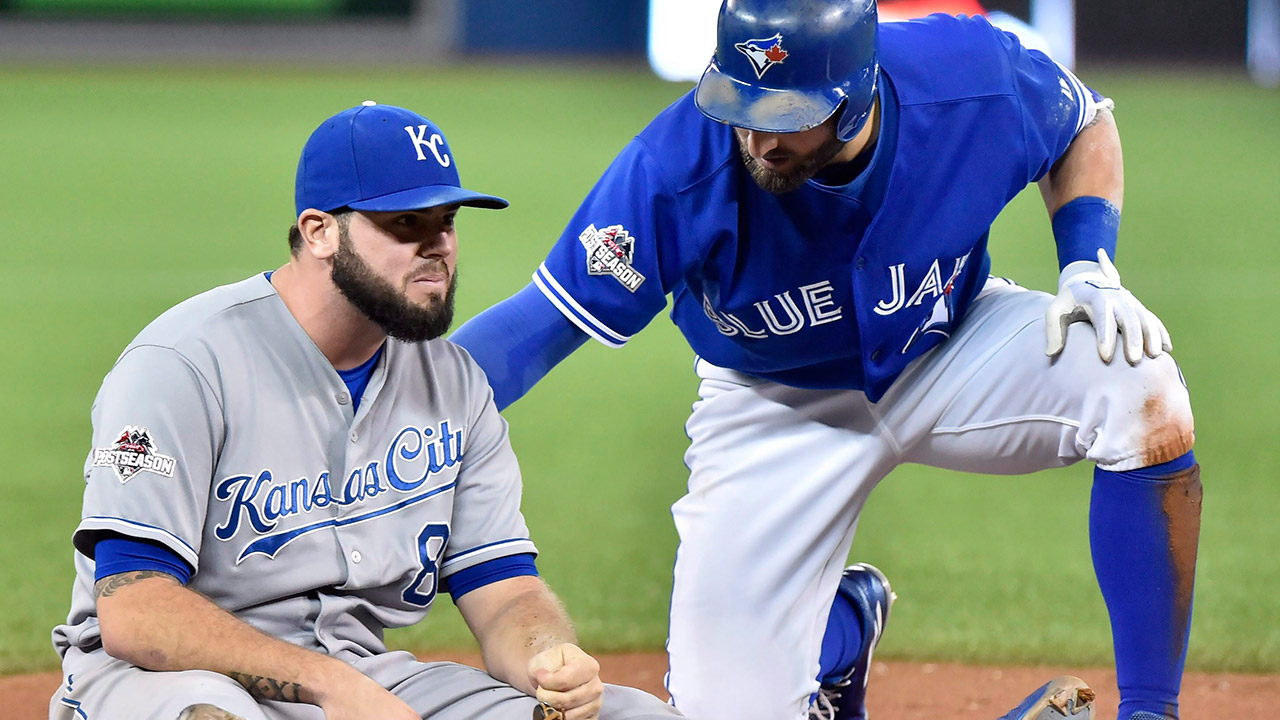 Toronto Blue Jays' Kevin Pillar checks on Kansas City Royals' third baseman Mike Moustakas (Nathan Denette/CP)