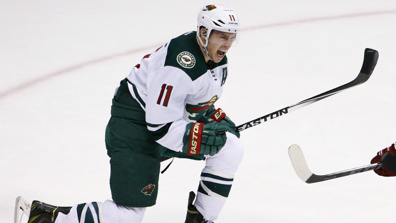 Minnesota Wild's Zach Parise celebrates his game-tying goal against the Arizona Coyotes during the third period of an NHL hockey game Saturday, Dec. 13, 2014, in Glendale, Ariz. The Wild defeated the Coyotes 4-3 in a shootout. (AP Photo/Ross D. Franklin)