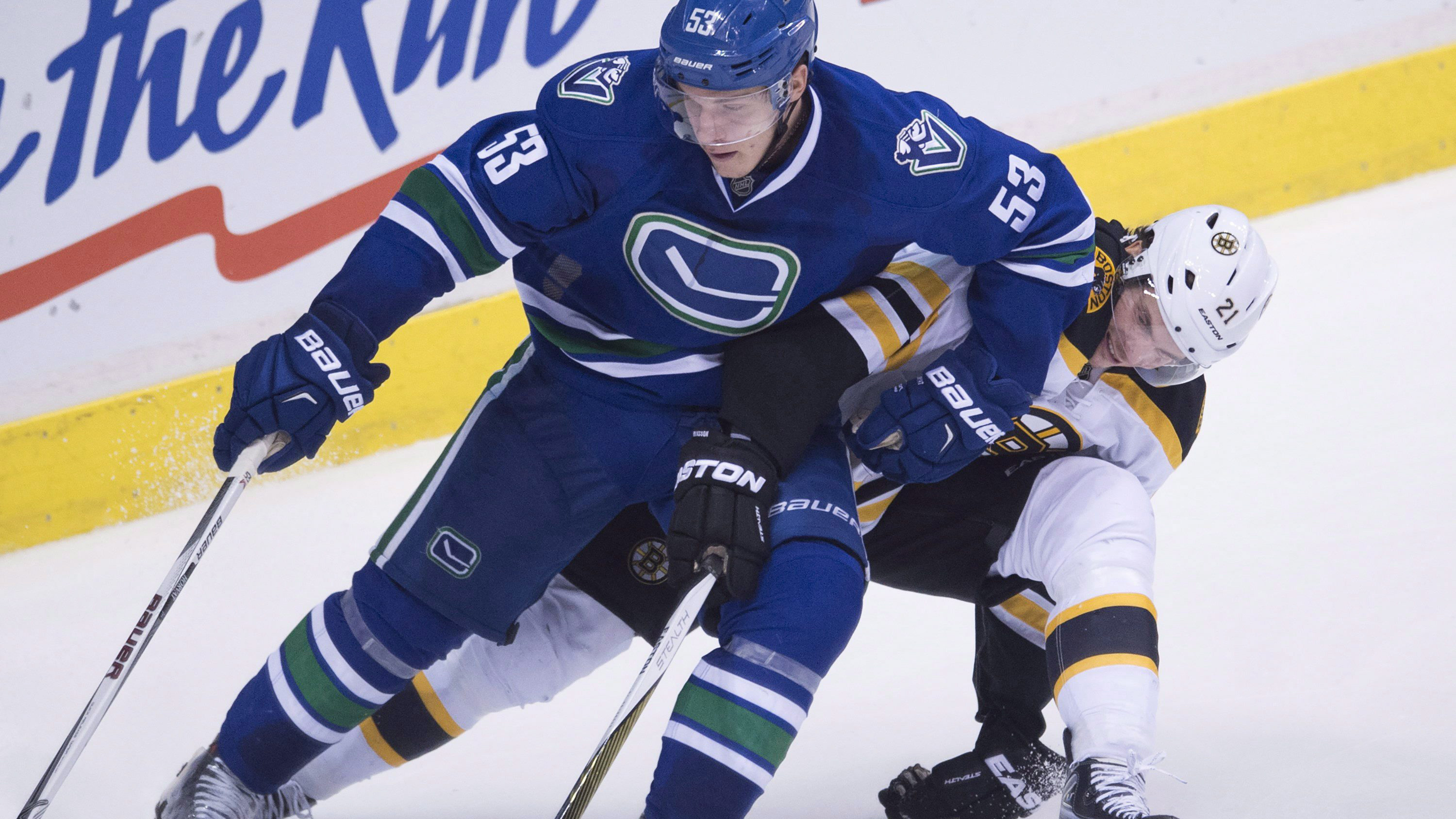 Vancouver Canucks centre Bo Horvat (53) fights for control of the puck with Boston Bruins left wing Loui Eriksson (21). (Jonathan Hayward/CP)