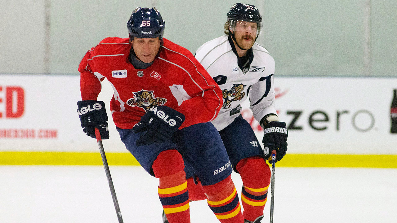 Florida Panthers' Ed Jovanovski (55) and Kris Versteeg (32) chase a puck at a practice in Coral Springs, Fla., Sunday, Jan. 13, 2013. (J Pat Carter/AP)