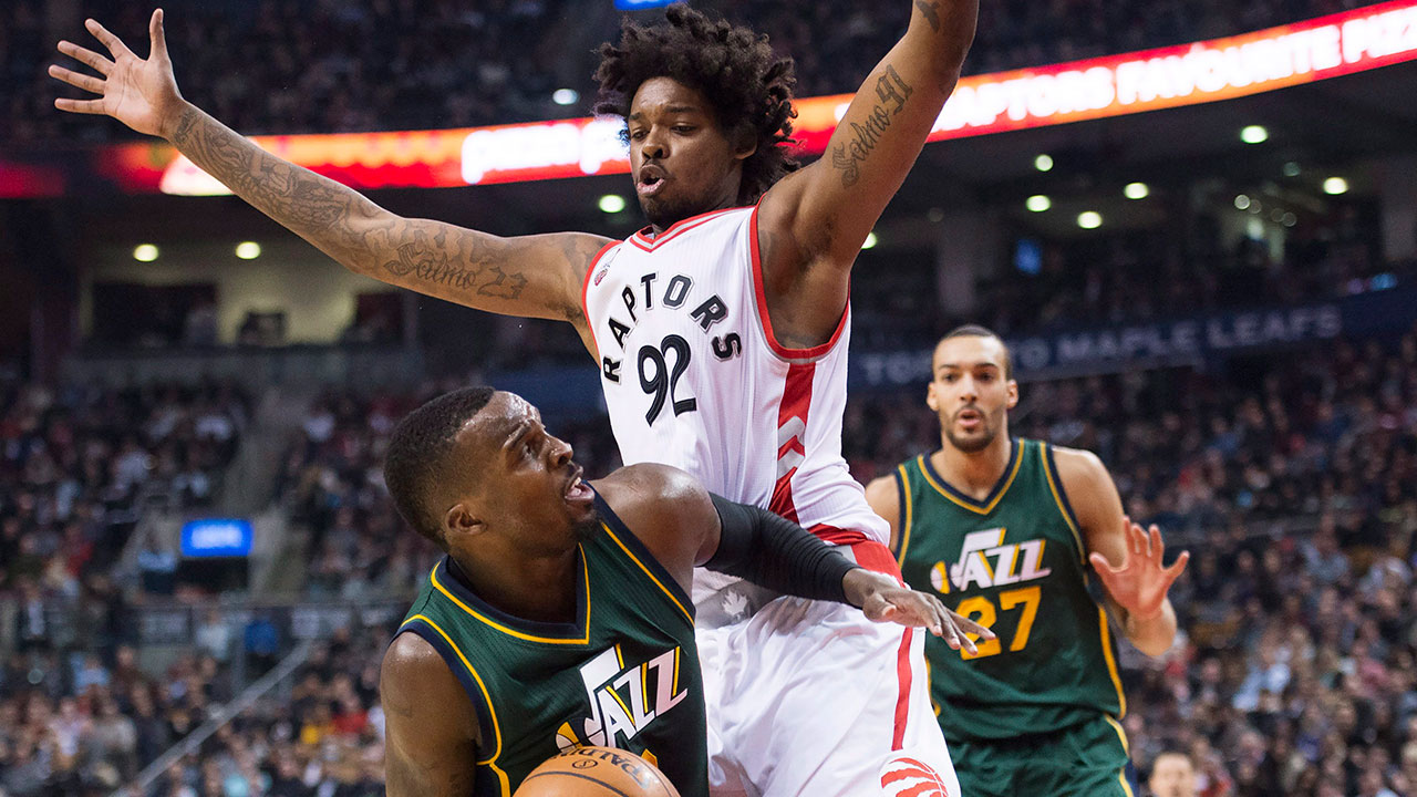 Toronto Raptors centre Lucas Nogueira (92) defends against Utah Jazz guard Shelvin Mack (Nathan Denette/CP)