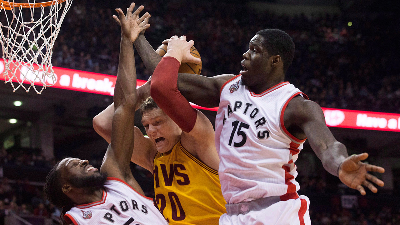 Cavaliers' Mozgov, is fouled by Raptors' Carroll, left, as Bennett defends (Chris Young/CP)
