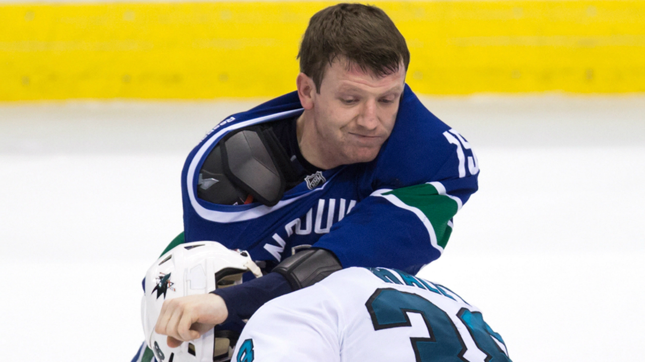 Vancouver Canucks' Derek Dorsett, top, and San Jose Sharks' Michael Haley fight during the second period of an NHL hockey game in Vancouver, B.C., on Thursday March 3, 2016. THE CANADIAN PRESS/Darryl Dyck