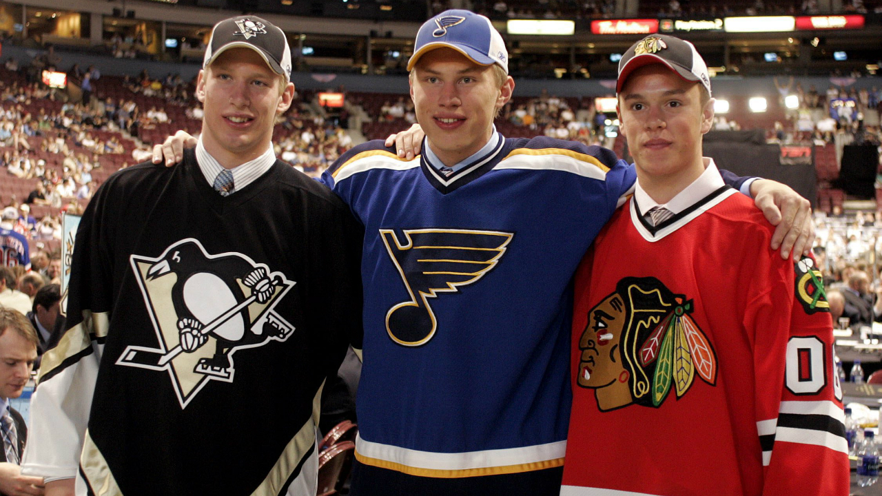 St. Louis Blues and number one overall pick Erik Johnson (centre), Pittsburgh Penguins and number two overall draft pick Jordan Staal (left) and Chicago Blackhawks and number three overall pick Jonathan Toews pose for a photo at the 2006 NHL Entry Draft in Vancouver, B.C., Saturday, June 24, 2006. (CP PHOTO/Chuck Stoody)