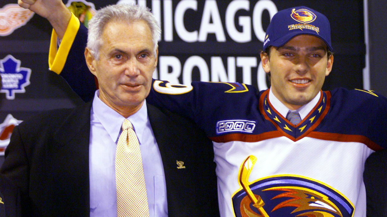 Patrik Stefan, from the Czech Republic, poses with Atlanta Thrashers' President Harvey Schiller after being selected first in the 1999 NHL Entry Draft in Boston Saturday, June 26, 1999 (CP PHOTO/stf-Ryan Remiorz)