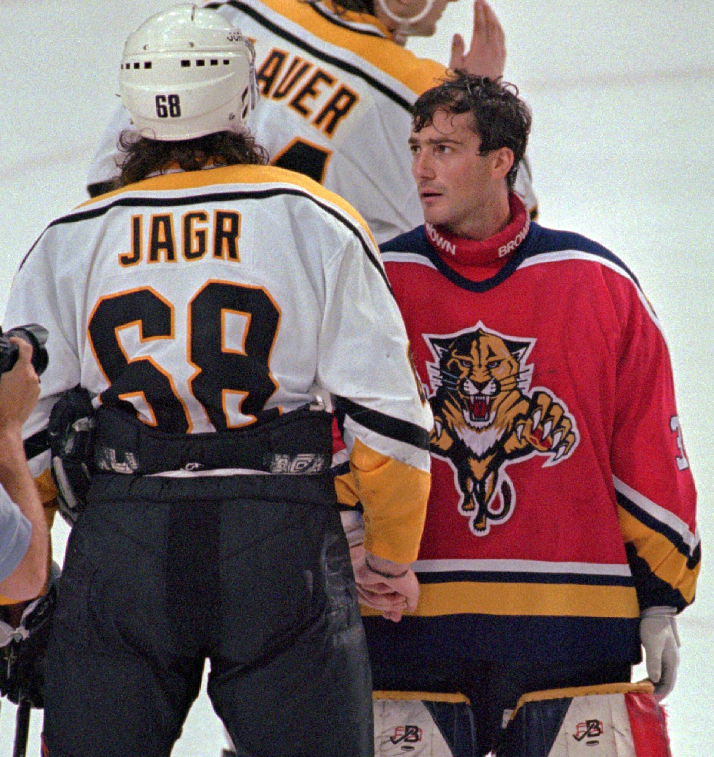 Florida Panthers goalie John Vanbiesbrouck, right, shakes hands with Pittsburgh Penguins Jaromir Jagr after game 7 of their Eastern Conference playoff series in Pittsburgh, Saturday June 1, 1996. The Panthers defeated the Penguins 3-1 and will meet the <a href=