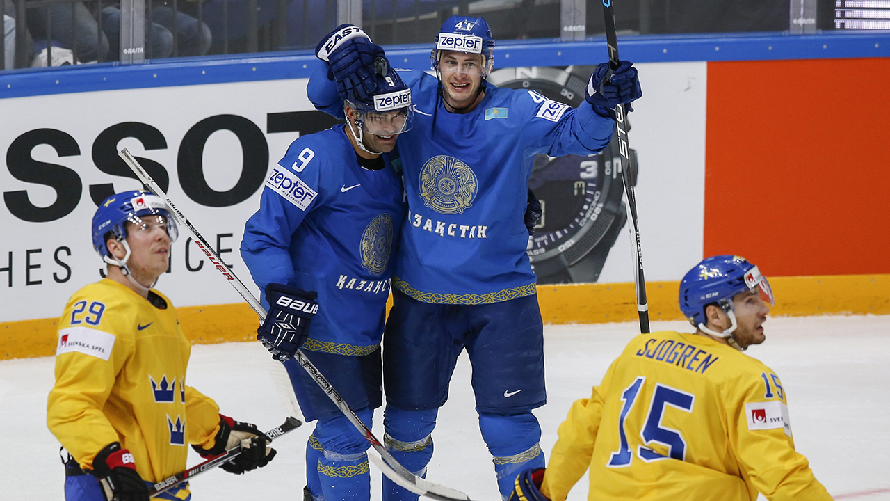 Kazakhstan's Dustin Boyd, center right, celebrates after scoring a goal with his teammate Nigel Dawes. (Pavel Golovkin/AP)