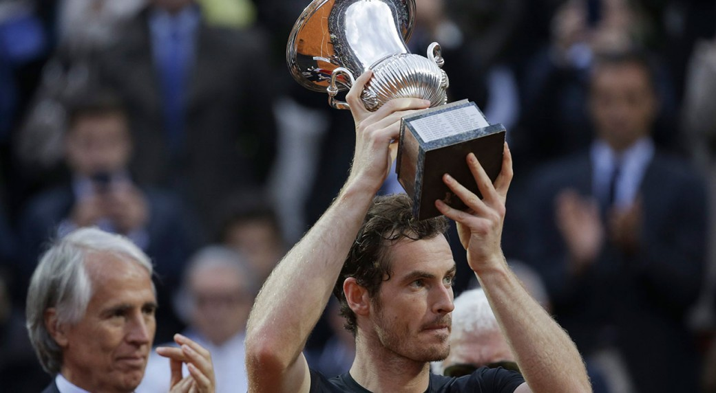 Andy murray holds the trophy after beating novak djokovic 6 3 6 3 in