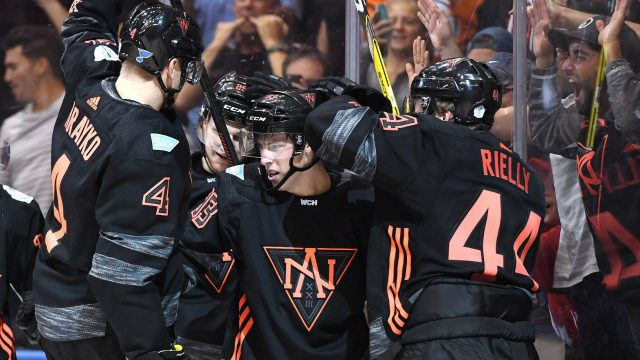 Team-North-America's-Colton-Parayko-(4)-Nathan-MacKinnon-(29)-and-Morgan-Rielly-(44)-congratulate-Ryan-Nugent-Hopkins-(93)-on-his-goal-during-third-period-World-Cup-of-Hockey-action-against-Team-Russia-in-Toronto-on-Monday,-September-19,-2016.-THE-CANADIAN-PRESS/Frank-Gunn