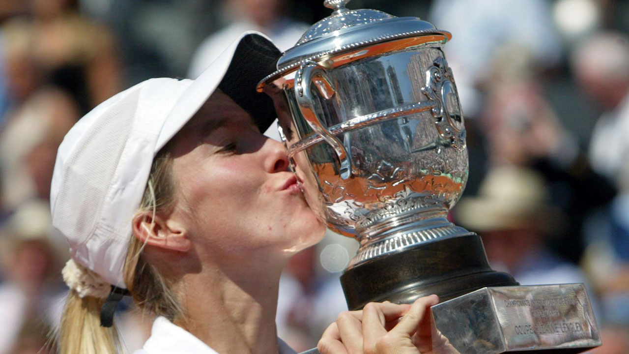 Justine Henin kisses the cup after winning the 2003 French Open. (Michel Euler/AP)
