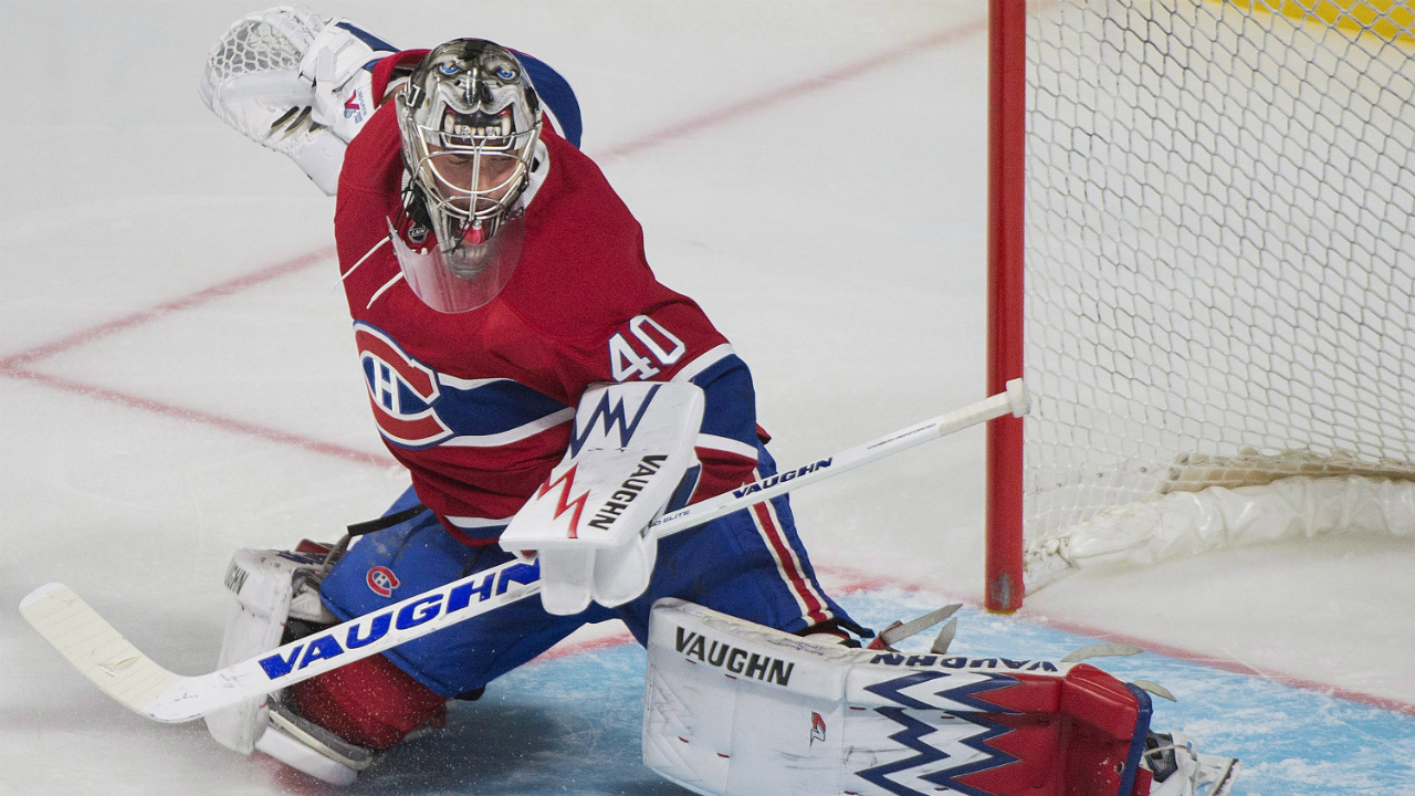 Montreal Canadiens goalie Charlie Lindgren makes a save during third period NHL pre-season hockey action against the New Jersey Devils in Montreal, Monday, September 26, 2016. (Graham Hughes/CP)