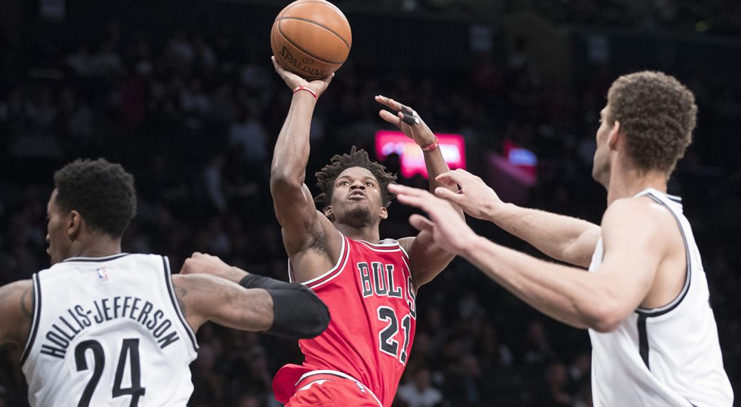 04471d92d2c Chicago Bulls forward Jimmy Butler (21) shoots past Brooklyn Nets forward  Rondae Hollis-Jefferson (24) and center Brook Lopez during the second half  of an ...
