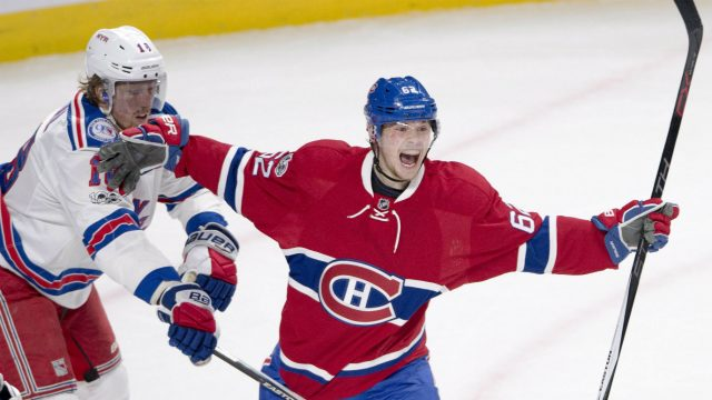 Montreal-Canadiens-left-wing-Artturi-Lehkonen-(62)-reacts-after-scoring-the-first-goal-as-New-York-Rangers-defenceman-Marc-Staal-(18)-looks-on-during-first-period-of-Game-5-NHL-Stanley-Cup-first-round-playoff-hockey-action-in-Montreal-on-Thursday,-April-20,-2017.-(Ryan-Remiorz/CP)