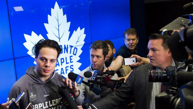 Toronto-Maple-Leafs-centre-Auston-Matthews,-left,-speaks-to-the-media-during-the-year-end-locker-room-clean-out-and-press-conference-in-Toronto-on-Tuesday,-April-25,-2017.-The-Maple-Leafs-were-eliminated-from-in-round-one-of-the-playoffs-by-the-Washington-Capitals-in-six-games.-(Nathan-Denette/CP)
