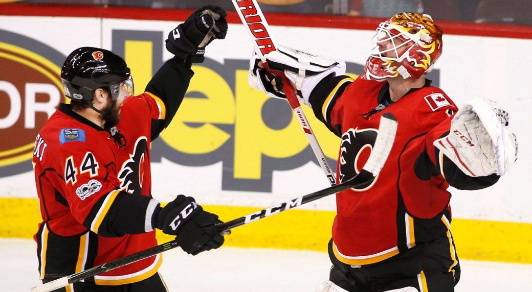 Flames beat Sharks 5-2 to clinch playoff berth