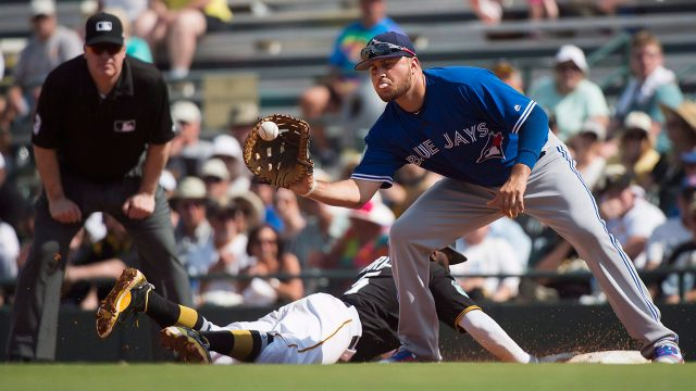 Brewers catcher Vogt out at least a month with sprained knee