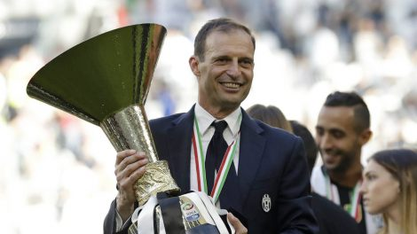 Juventus-coach-Massimiliano-Allegri-holds-the-trophy-as-Juventus-players-celebrate-winning-an-unprecedented-sixth-consecutive-Italian-title,-at-the-end-of-the-Serie-A-soccer-match-between-Juventus-and-Crotone-at-the-Juventus-stadium,-in-Turin,-Italy,-Sunday,-May-21,-2017.-(Antonio-Calanni/AP)