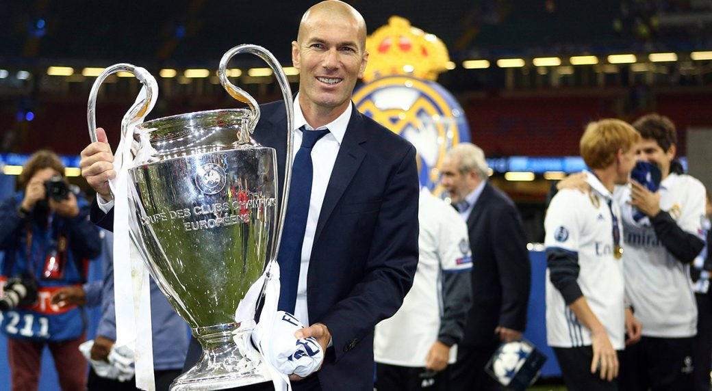 01b0c15bba2f Real Madrid's head coach Zinedine Zidane celebrates with the trophy at the  end of the Champions League soccer final between Juventus and Real Madrid  at the ...