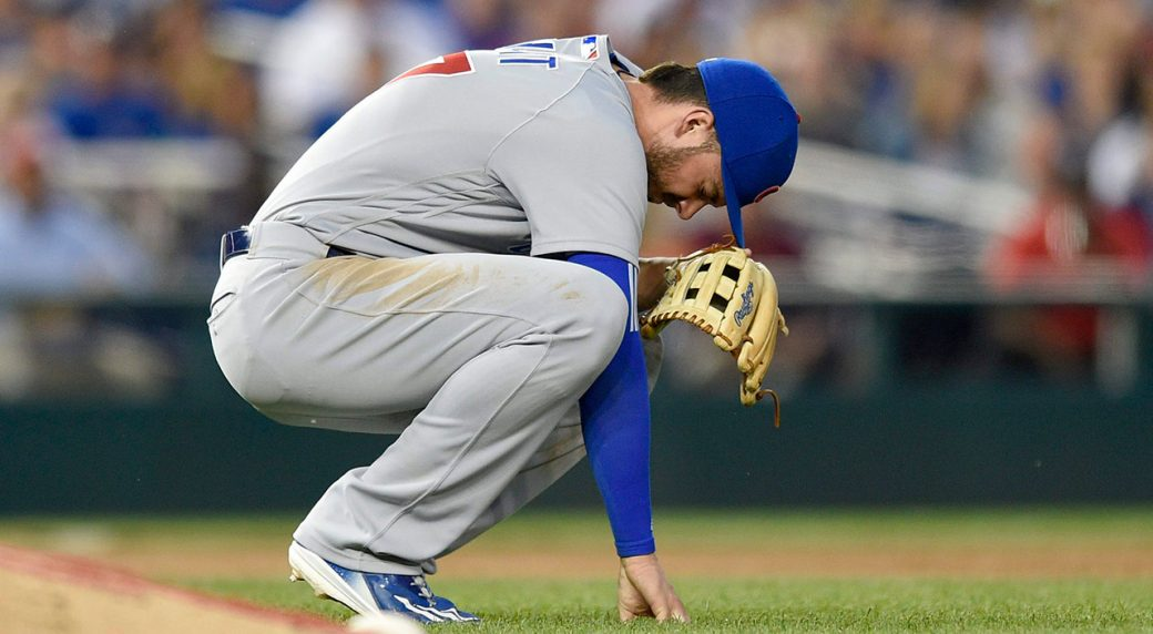 Chicago-Cubs-third-baseman-Kris-Bryant-pauses-on-the-field-after-he-made-a-catch-on-a-pop-up-by-Washington-Nationals'-Matt-Wieters-during-the-fifth-inning-of-a-baseball-game,-Wednesday,-June-28,-2017,-in-Washington.-Bryant-left-the-game-with-an-injury-on-the-play.-(Nick-Wass/AP)