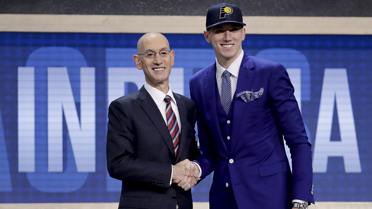 b1f9be6fe4bf9e T.J. Leaf poses for photos with NBA Commissioner Adam Silver after being  selected by the Indiana Pacers as the 18th pick overall during the NBA  basketball ...
