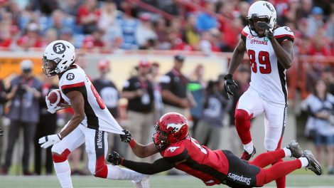 Calgary-Stampeders'-Ciante-Evans-(0)-tries-to-tackle-Ottawa-Redblacks'-Diontae-Spencer-(85)-in-second-half-CFL-action-in-Calgary,-Thursday,-June-29,-2017.-Spencer-did-his-best-to-keep-the-Ottawa-Redblacks-within-striking-distance-of-the-Calgary-Stampeders-on-Thursday-night.-(Mike-Ridewood/AP)