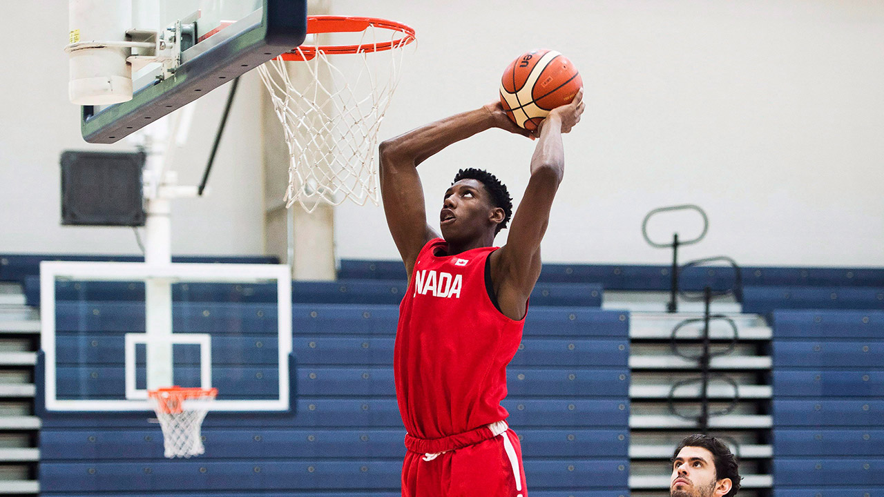 R.J. Barrett, 17, slam dunks the ball during his U-19 basketball Canada team practice in Mississauga, Ont., on Tuesday, June 20, 2017. (Nathan Denette/AP)