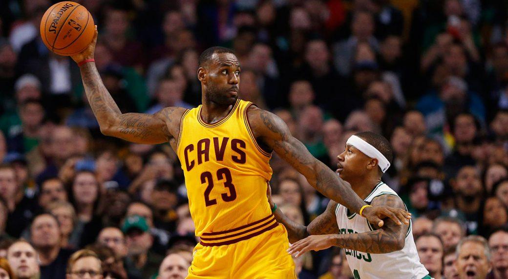 d3e1edd9c338 Cleveland Cavaliers forward LeBron James holds the ball away from Boston  Celtics guard Isaiah Thomas (Winslow Townson AP)