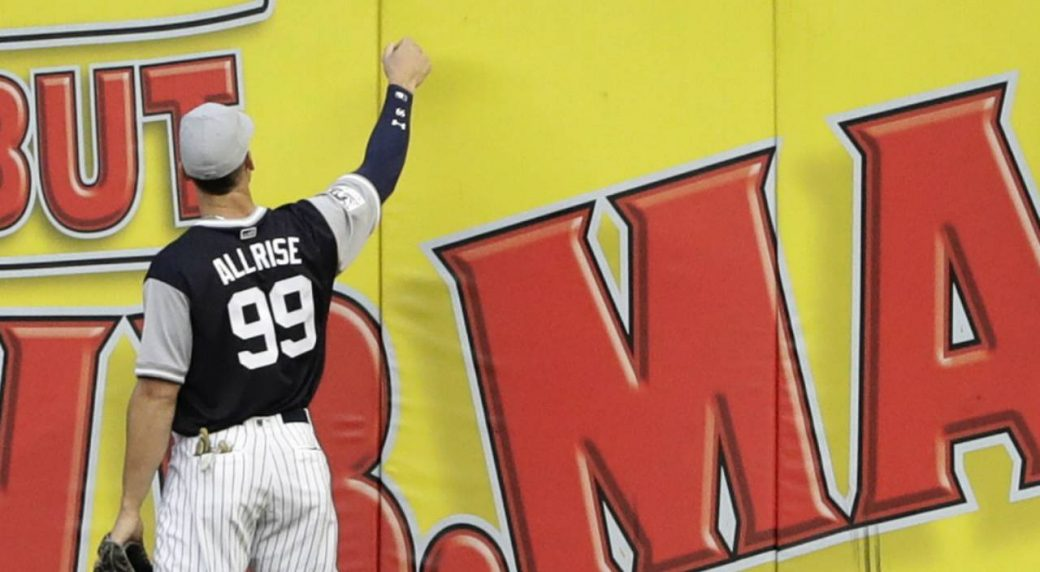 New York Yankees right fielder Aaron Judge hands a ball to fans wearing a  jersey with his nickname on the back before a baseball game against the  Seattle ... 299fcc50d4a4