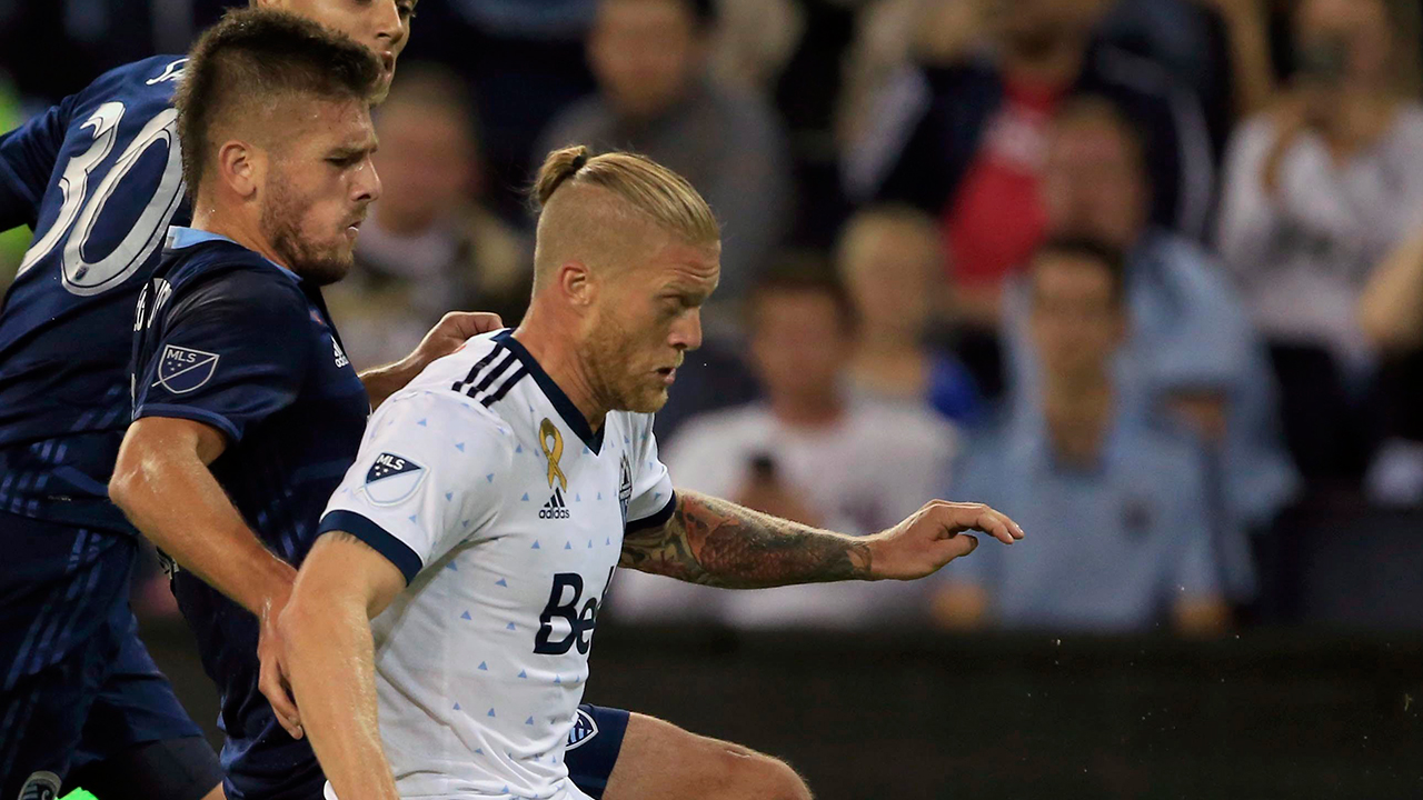Whitecaps clinch playoff spot with win over Sporting KC