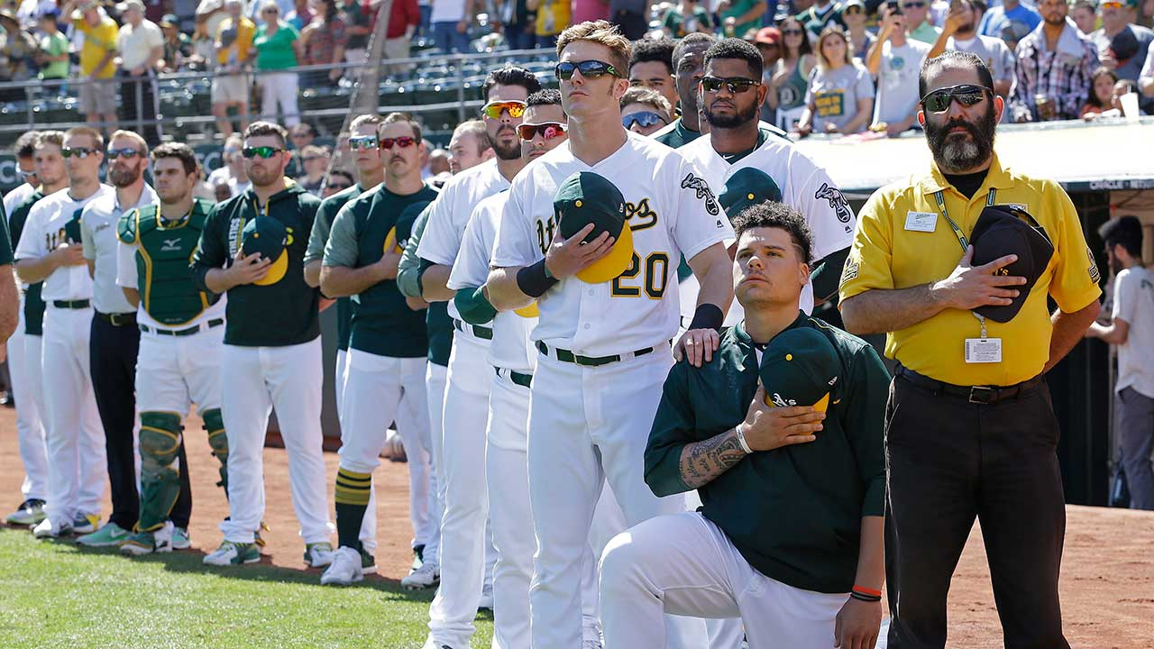 A's catcher Bruce Maxwell kneels during anthem for second straight day