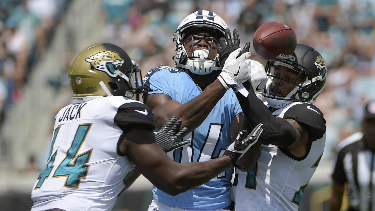 Titans dominate 2nd half, humble Jaguars