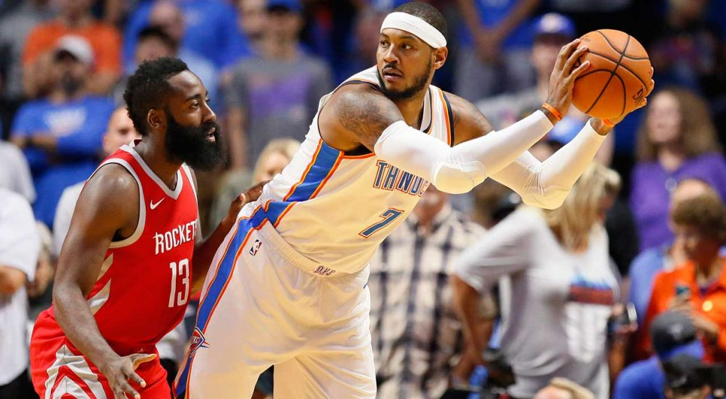 315850745c4 Oklahoma City Thunder forward Carmelo Anthony (7) is guarded by Houston  Rockets guard James Harden (13) in a pre-season game. (Sue Ogrocki AP)