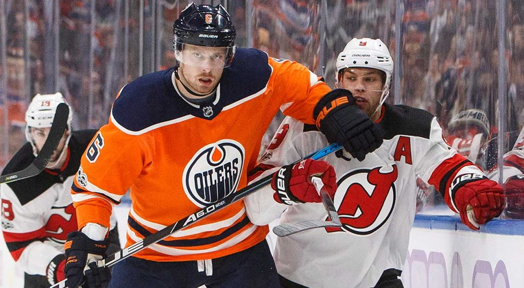 New Jersey Devils  Taylor Hall (9) is checked by Edmonton Oilers  Adam  Larsson (6). (Jason Franson CP) e0f891dd5